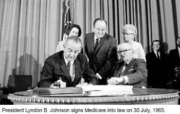 LBJ Signs Medicare Bill