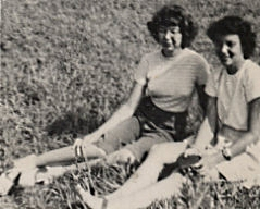 Lyn Burnstine and friend on lawn