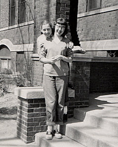 Lyn Burnstine and friend on dorm steps