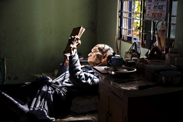 Burma: old man reading