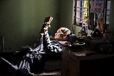 Burma: old man reading